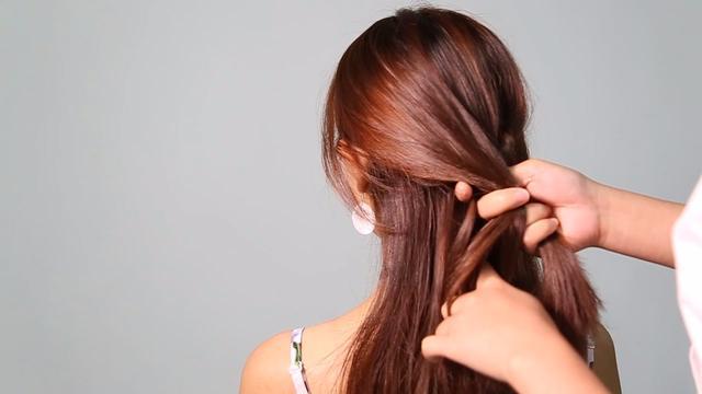 长头发的扎法图解_造型方法_西子美发网
