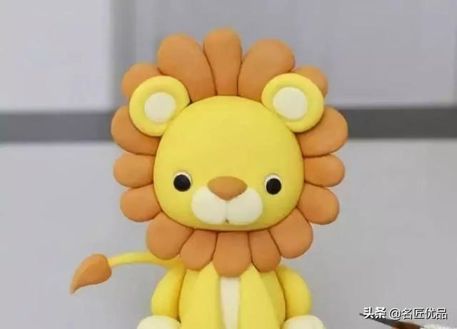树叶画手工贴画狮子