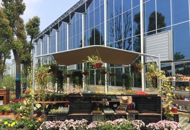 北方地区最爱的休闲景观玻璃温室如何建造?小型阳光房温室造价