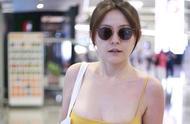 演员热依扎机场低胸装大肚腩惹争议
