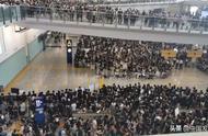 """香港机场恢复办登机手续,黑衣人扬言""""再接机"""""""