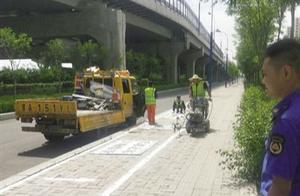 赛罕区施划95处停车位规范自行车停放