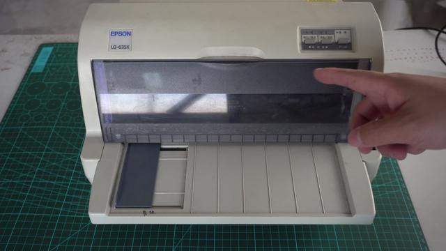 爱普生打印机色带盒里的弹簧在什么位置