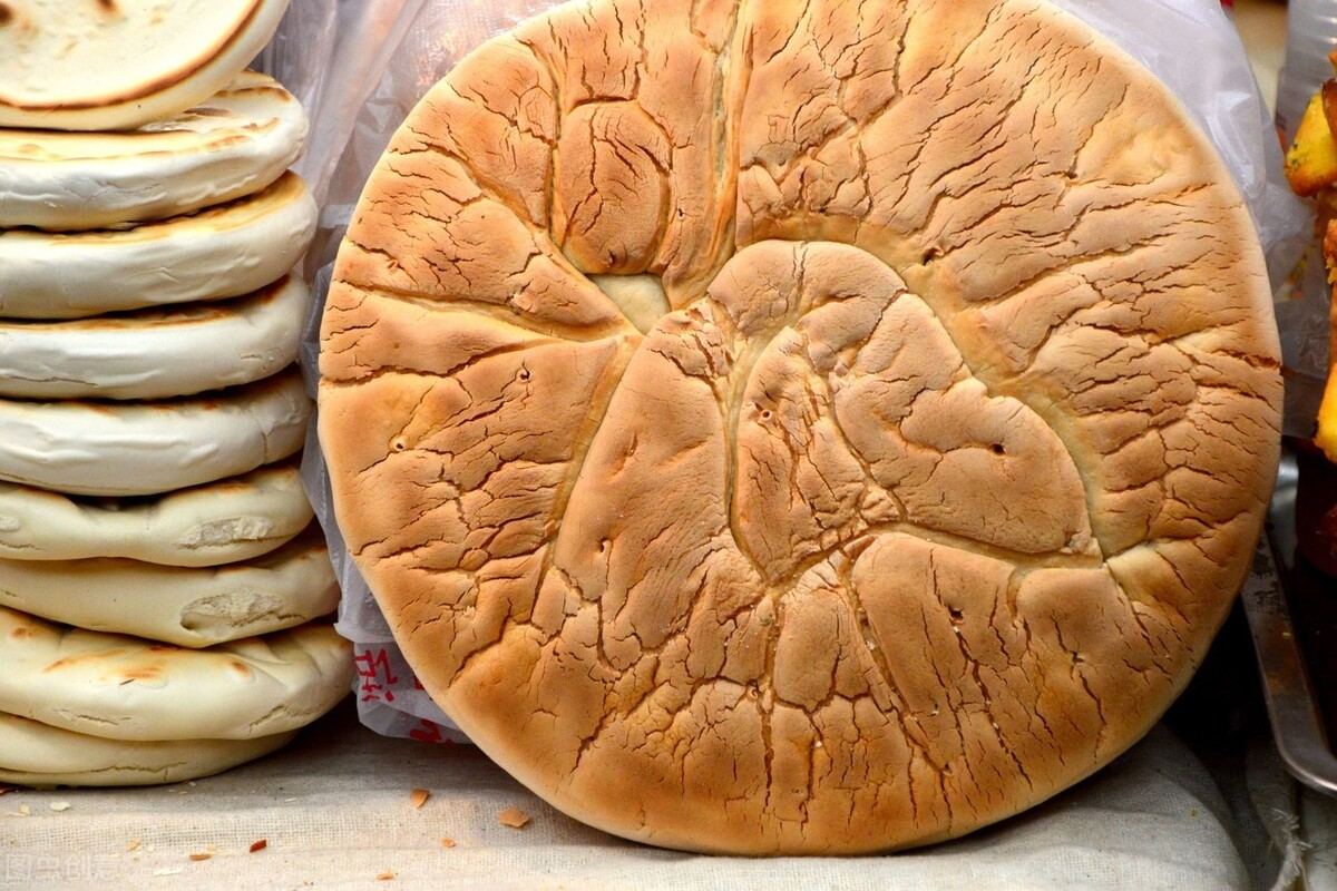 陕西这饼很忒色,不仅能挂在脖子上,还能当盾牌用,是什么知道么