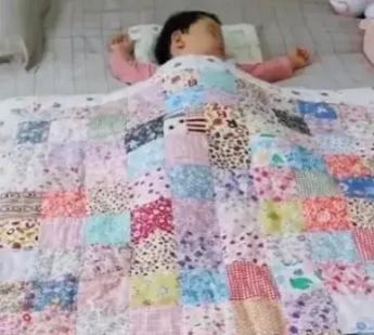 暖!姥姥为早产外孙女缝制百家被:希望外女儿健康长大