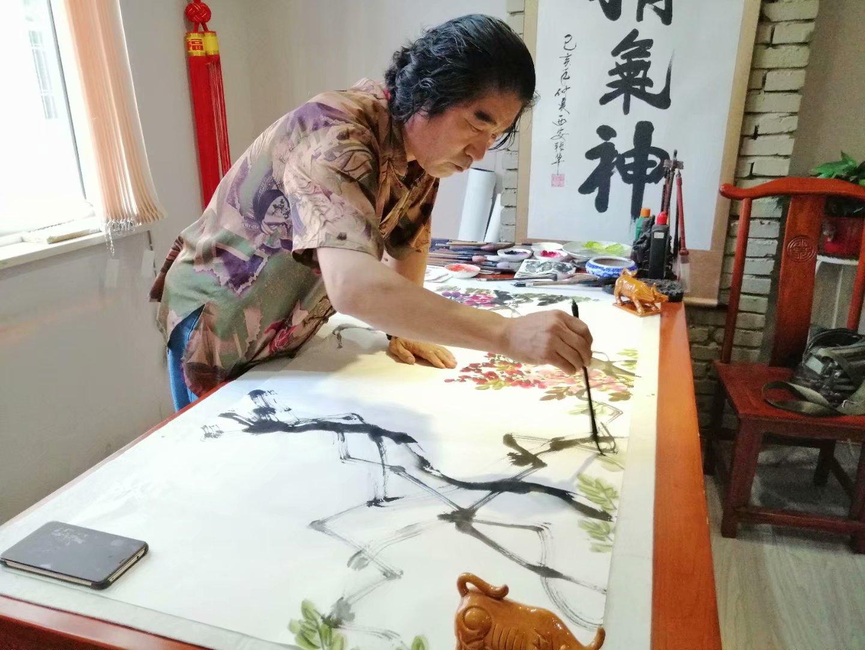 春光灿烂影业邀请著名画家潘金阳来公司参观交流