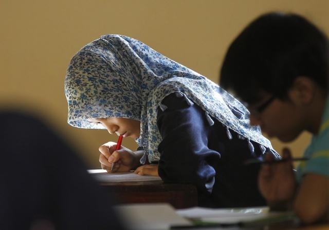 只有处女才能当兵。56年来,这项规定害惨了无数印尼女性