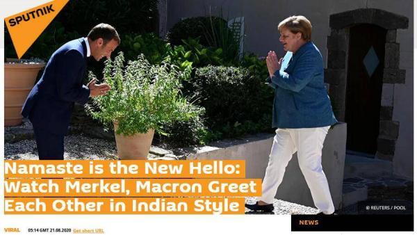 """马克龙""""做东""""迎接默克尔,两人以""""合十礼""""互致问候"""