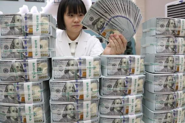 美元以创纪录的速度涌入中国,人民币全面开放势在必行